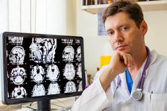 Doctor with an mri scan of the brain Stock Photos
