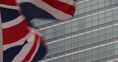 Ultra HD 4K United Nations Building in NYC British Flag Waving Blowing Wind Stock Footage