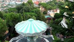 Tilt shot at Barcelona city and carousel in Tibidabo Park HD Stock Footage
