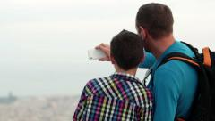 Father and son using smartphone and taking picture of themselves HD Stock Footage