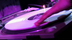 DJ spinning the vinyl in the club Stock Footage