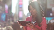 Stock Video Footage of African American black cosmopolitan woman using tablet pc