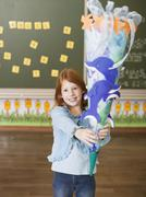 Girl holding schoolcone Stock Photos