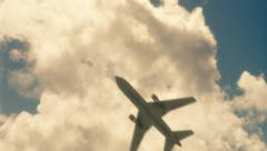 Plane flying under time lapsed clouds Stock Footage