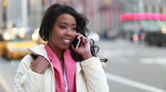 African American black cosmopolitan woman talking on cellphone - stock footage