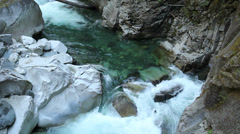 Turbulent Creek and Water Worn Rocks Stock Footage