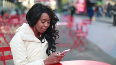 African American black cosmopolitan woman texting in New York City - stock footage