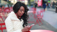 Stock Video Footage of African American black cosmopolitan woman texting in New York City
