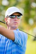 athletic young man playing golf - stock photo
