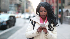 African American black business woman texting smart phone in New York City - stock footage