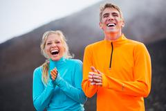 Young attractive athletic couple, wearing sporty cloths on trail Stock Photos