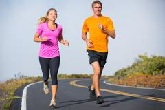 fitness sport couple running jogging outside - stock photo
