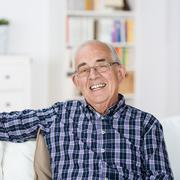 happy senior man with a beaming smile - stock photo