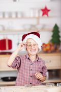 happy young boy baking christmas cookies - stock photo