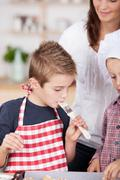 little boy tasting the baking - stock photo