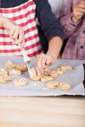 Young child decorating cookies Stock Photos