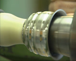 Stock Video Footage of Manufacturing a tin cup on a turning lathe - cu shaping ridges