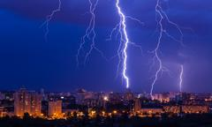 Lightning storm over city Stock Photos