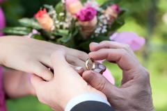 Wedding ring putting Stock Photos