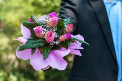 man with bouquet of roses - stock photo