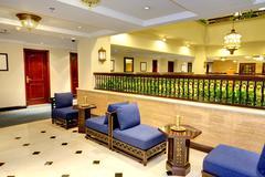 interior of the luxury hotel in night illumination, ajman, uae - stock photo