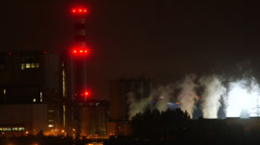 Industrial plant with smoke chimneys at night Stock Footage