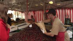 Man selling cherries on the market. Garmisch-Partenkirchen. Bavaria. Germany. Stock Footage