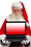 Santa holding a laptop Stock Photos
