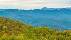 Pan Over the Blue Ridge Mountains with Fall Colored Trees and Layered Mountains Stock Footage