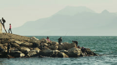Timelapse of fishermen catching fish from a pier of main harbor in Antalya, Turk - stock footage