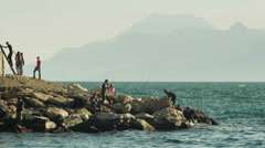 Fishermen catching fish from a pier of main harbor in Antalya, Turkey Stock Footage