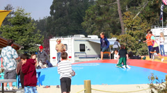 Kids playing and jumping Stock Footage