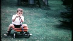Boy takes a fast wagon ride down a hill, 583 vintage film home movie Stock Footage