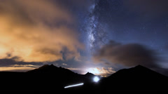 Milky way clouds traffic in mountain time lapse pan 11201 Stock Footage