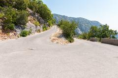 Curve on winding road in biokovo mountains Stock Photos