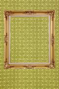 Stock Photo of isolated blank classic photo frame on fabric wall