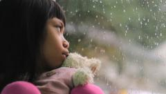 Depressed Little Asian Girl By The Window Stock Footage