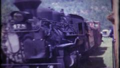 598 - engineer hangs outside the train caboose - vintage film home movie - stock footage