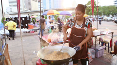 Street Vendor Frying a Huge Wok Of Pad Thai Noodles Stock Footage