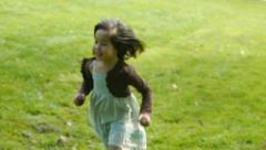 Cute Little Girl Running In The Park Stock Footage