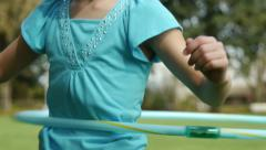 Close Up Of A Nine Year Old Girl Twirling Her Hula Hoop Stock Footage