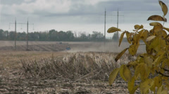 Autumn clouds float above plowed field Stock Footage