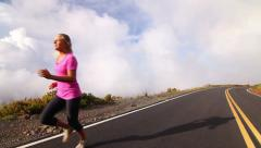 Young Blonde Female Running Above Clouds (Slow Motion) Stock Footage