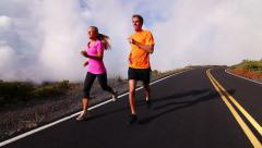 Attractive Young Couple Running Above Clouds Stock Footage