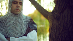 Tired knight with eyes closed 2 Stock Footage