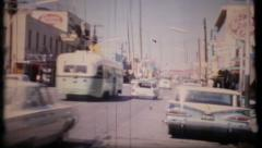 606 - street scene in anytown USA - vintage film home movie - stock footage
