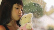 Stock Video Footage of Sad Seven Year Old Asian Girl By Window