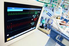 Neonatal icu with ecg monitor Stock Photos