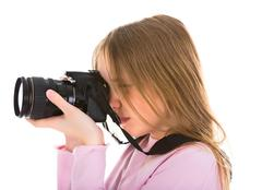 female photographer with her digital camera - stock photo