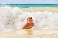 Stock Photo of boy in the waves